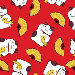 seamless pattern of a traditional cute luck and abundance symbol of a cat maneki neko and an open fan on a red background