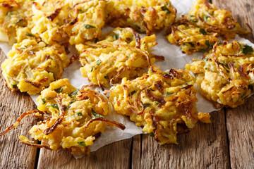 Indian food: crispy fried onion Bhajis close-up. horizontal