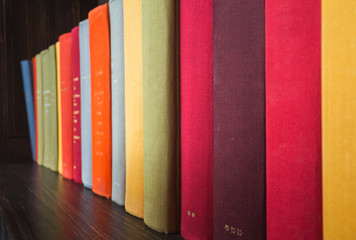 Old books in colorful covers, close up