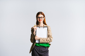 smiling girl with glasses holding a file with a document