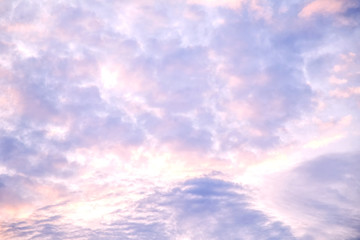 Evening sky with violet and yellow clouds