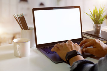 Cropped shot of Unrecognizable man using a modern laptop computer on desk in living room.