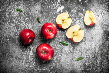 Fresh red apples. On rustic background.