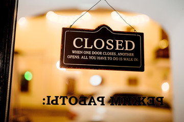 "Signboard on the door ""Closed"""