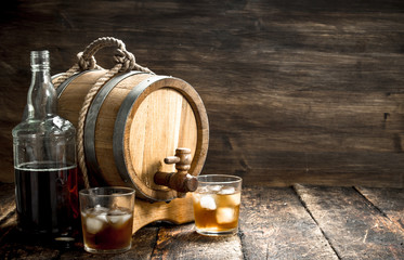 barrel of Scotch whiskey with a glass.