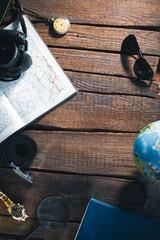 Still-life of the traveler. Clock, camera, map.