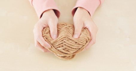 Woman hand holding knit wool