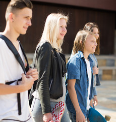teenagers communicate in schoolyard