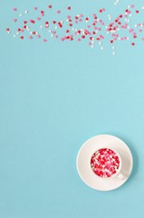 Coffee cup with colorful hearts