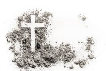 Christian cross or crucifix drawing in ash, dust or sand