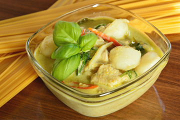Green curry soup with fish ball and chicken