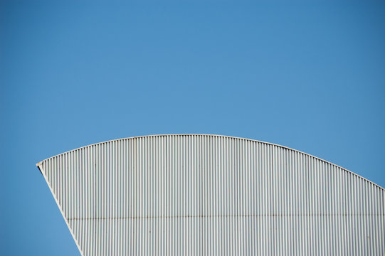 abstract facade modern architecture building with blue sky