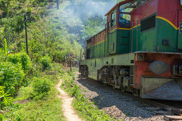 Shortly behind the nine arches bridge between Demodara and Ella, the track leads through a tunnel. The locomotive is on the way to Ella, in the highlands of Sri Lanka