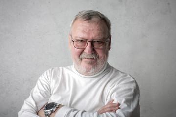 Elderly man wearing white clothes