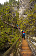 Woody bridge with walking tourists, Kitzlochklamm gorge, Austria