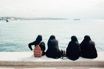 Women in a burqa near the sea
