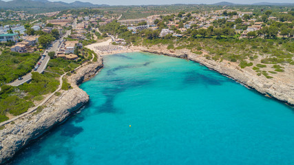 Drone aerial landscape of the beautiful bay of Cala Mandia with a wonderful turquoise sea, Porto Cristo, Majorca, Spain