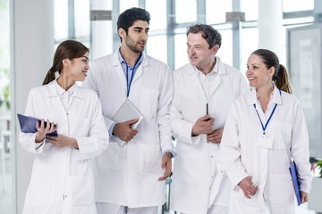 Medical colleagues walking in hospital building