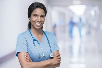 Female doctor smiling towards camera