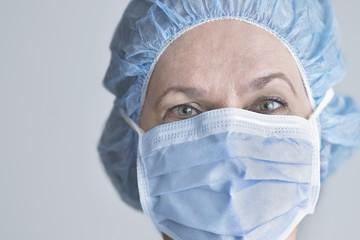 Female surgeon wearing surgical mask