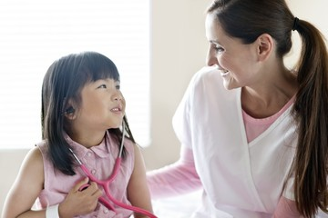 Girl and female nurse with stethoscope