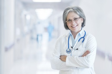 Portrait of smiling doctor standing in the hospital