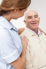 Nurse with senior male patient