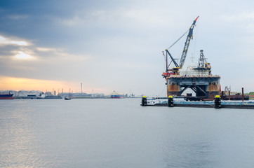 Semi-submersible crane vessel anchored in the port of Rotterdam, Netherlands.