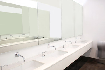 Modern sinks with mirrors in public toilet