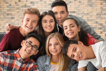 Group of funny teenagers indoors Wall mural