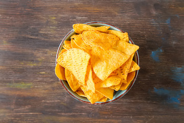 Snack for a party, chips with a tortilla, nachos  Mexican food. Dark background. Top view. Copy space
