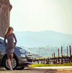 girl travelling by car in Tuscany