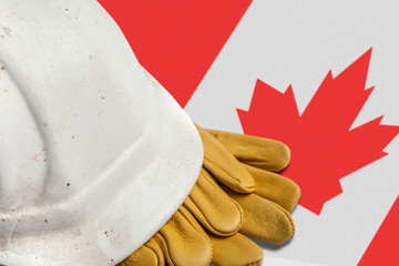 Construction Workers Hard Hat and Gloves on flag of Canada