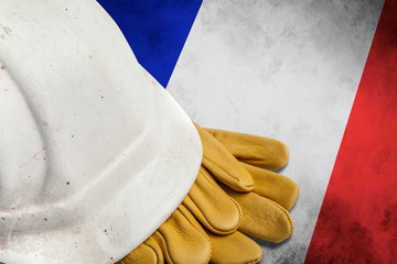Construction Workers Hard Hat and Gloves on flag of France