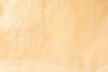 texture of a yellow cotton fiber surface forming a fabric, abstract background