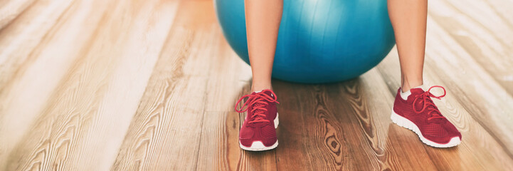 Fitness gym background panoramic banner with copy space on floor. Closeup of running shoes of...