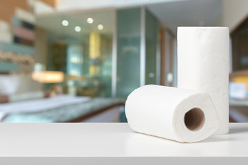 Soft paper towels on a white desk front view