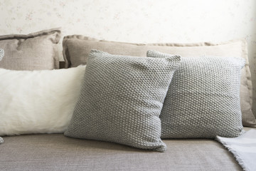 Gray and white pillow on white sofa in living room