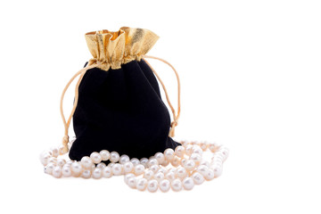 Black pouch and a stack of pearls