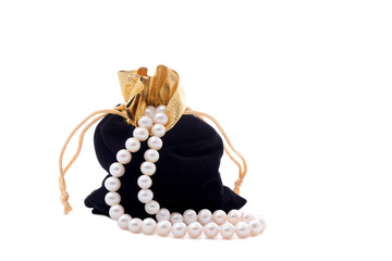 Black pouch and a beads of pearls