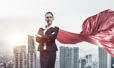 Concept of power and sucess with businesswoman superhero in big