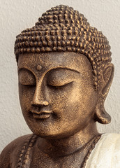 Siddhartha bronze statue. Close up of Buddha beautiful serene face with closed eyes. Best meditation inspiration image or mindfulness background.