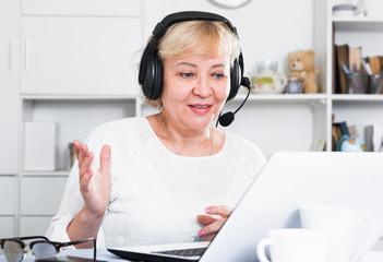 Mature woman communicates via the Internet