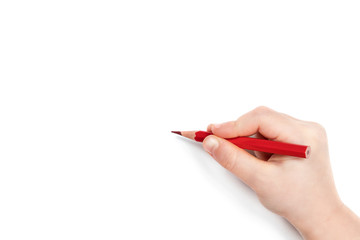 Child hand holding a red pencil and getting ready to draw, isolated on a white background