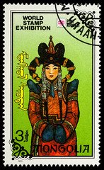 Mongolian woman in traditional dress on postage stamp