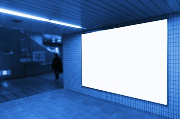 blank advertising billboard or big light box showcase on wall at airport or subway train station, blue color tone, copy space for your text message or media content, commercial and marketing concept