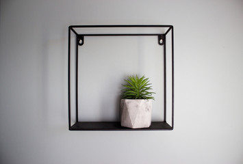 black shelves in loft style on a white wall