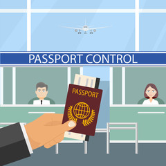 Passport control at the airport. The hand stretches passport to passport control.