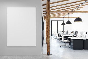 Coworking office with blank poster
