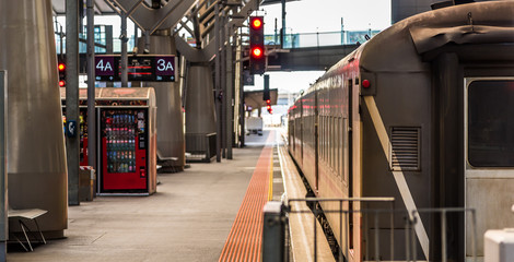 A passenger train waits at platform 3A at Southern Cross Station in Melbourne Australia